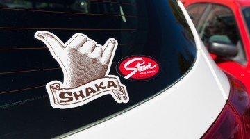 A Shaka sticker and a Stowe sticker on a car, custom made by Websticker